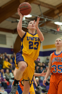 Photo by Jack McLaughlin. Alyssa Olp drives to the hoop and puts up a shot.