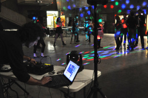 Photo by Emily Hoffmann. The DJ prepares the next track at the COFAC dance on Saturday night.