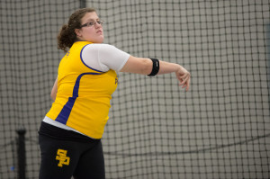 Photo by Jack McLaughlin. Maggie Martin broke school weight throw record in the Pointers first meet of the season.
