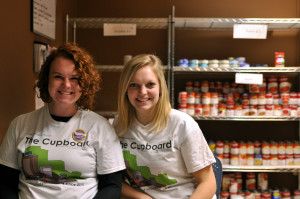 Photo by Emily Hoffmann. Junior Lizzie Billington and sophomore Carli Navin are among the students who volunteer at The Cupboard.