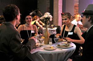 Photo by Emily Hoffmann. Diane Ray, Rebecca Jankowski, Lars VanAlstine, and Kurt Bennett, freshmen, make conversation at the murder mystery dinner on Saturday.