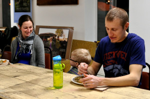 Photo by Emily Hoffmann. Jared Campbell, Sean Campbell, and Laura Selin enjoy their meal at the Farmshed potluck.