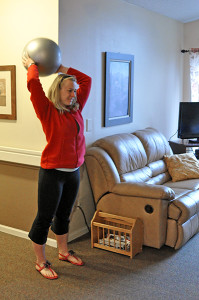Photo by Emily Hoffmann Mariah Pfundheller plays ball with a resident at the assisted living home Sylvan Crossings.