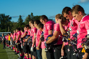 Players line up on the sideline for the Pink Game last year. Photo by Jack McLaughlin.