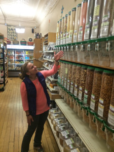 Jenny Bellmer displays the bulk items at the co-op. Photo by Harley Fredriksen.