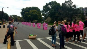 Passerbys await garbage can races. Photo by Allison Birr.