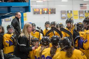 Head Coach Ann Ninnemann talks to her team during a timeout. Photo by Jack McLaughlin.