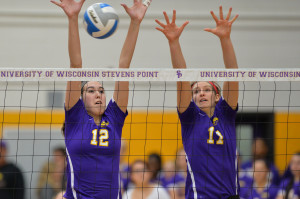 Emma Brunkhorst (#12) and Krista Loos (#17) team up for a block. Photo by Jack McLaughlin.