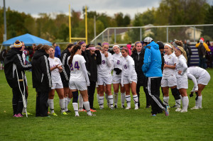 Soccer team huddles before the game. Photo by Jack McLaughlin.