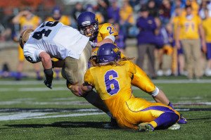 Zach Vallafskey (#6) and Matt Gaffney (#21) team up for a tackle against Eau Claire. Photo by Jack McLaughlin.