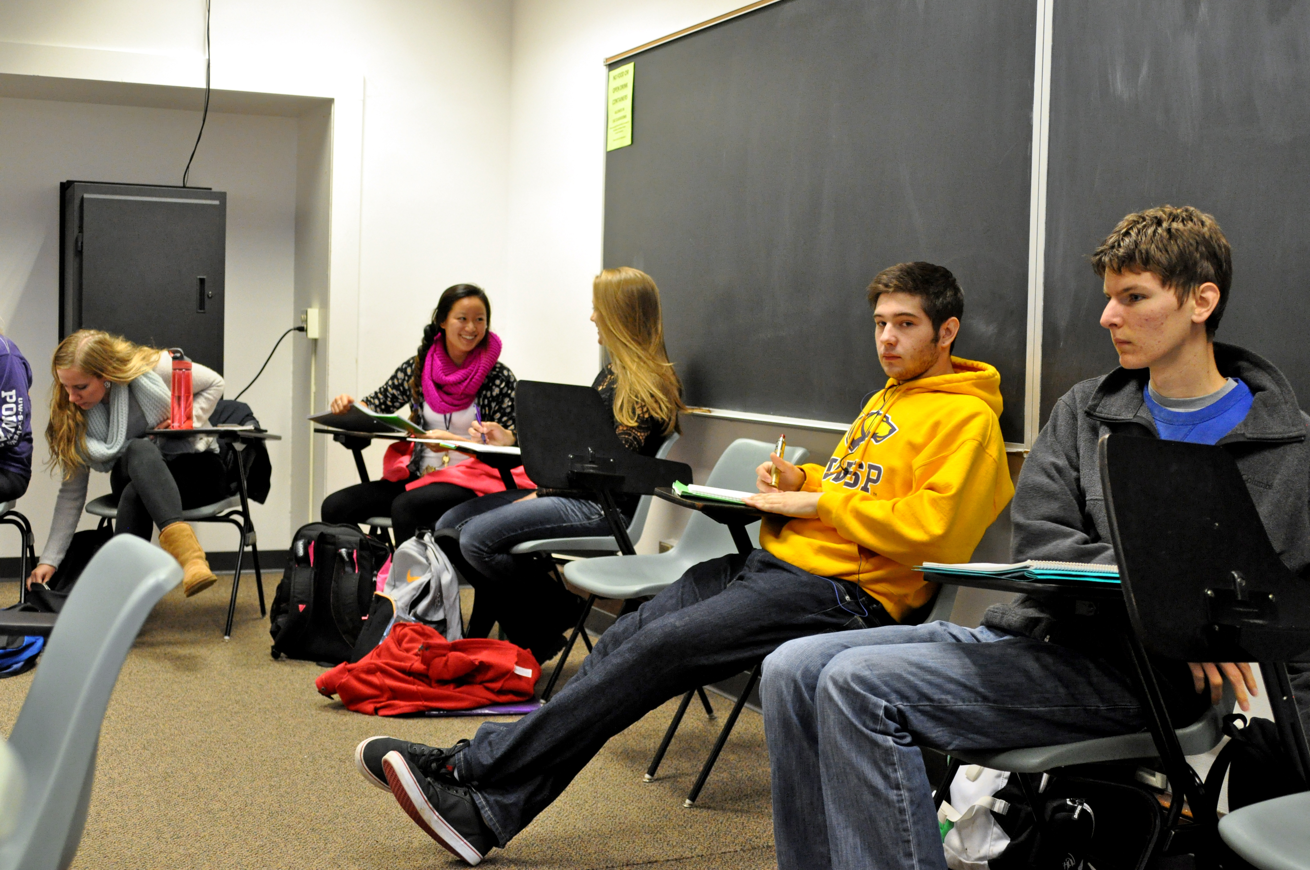Students prepare to take notes on a video in Professor Stoner's FYS class. Photo by Emily Hoffmann.
