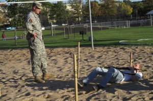 Students crawl through sand pits during the ROTC lab. Photo by Emily Showers.