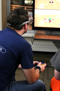 Chris Cleworth, junior, plays Mario Kart while wearing drunk goggles to simulate drunk driving. Photo by Emily Hoffmann.