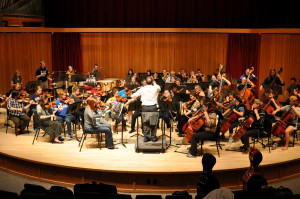 The symphony orchestra rehearses for their first fall concert which will take place Wednesday. Photo by Emily Hoffmann.
