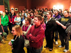 """Students, staff, faculty and community members gather to watch video projects for """"Beyond the Hive."""" Photo by Jade Arnold."""