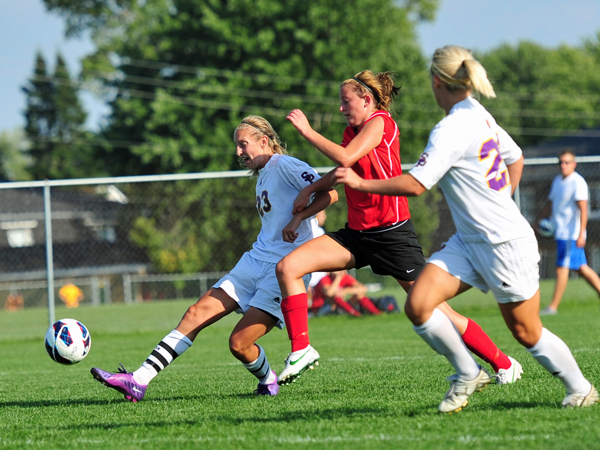 Jessica Ruch races against a Carthage player.  Photos by Jack McLaughlin.