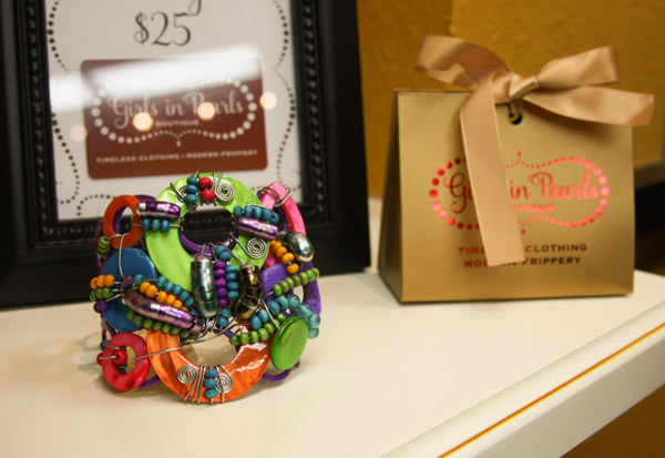 Unique jewelry pieces are some of the items available at Girls in Pearls. The store also carries clothing and accessories such as scarves and purses.