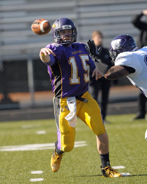 Quarterback Mitch Beau throws a pass to an awaiting  teammate. Photo by Jack Mclaughlin.