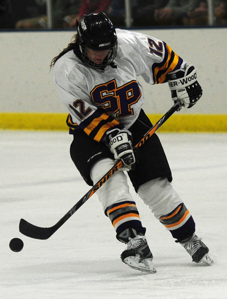 During the game against St. Scholastica, Ariel Novak looks for an open  player.  Photo by Jack McLaughlin