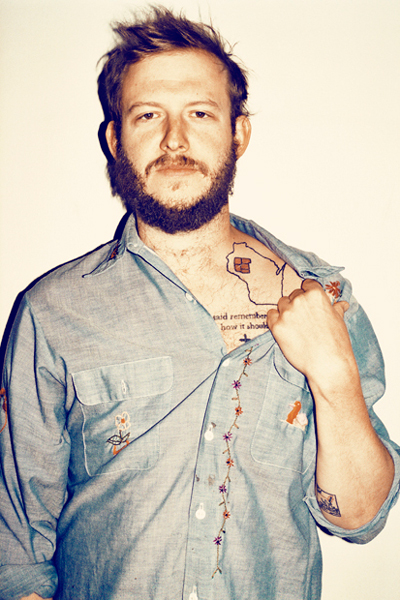 ​Justin Vernon, otherwise known as Bon Iver, shows off his Wisconsin tattoo. Photo Courtesy of btracks.com.