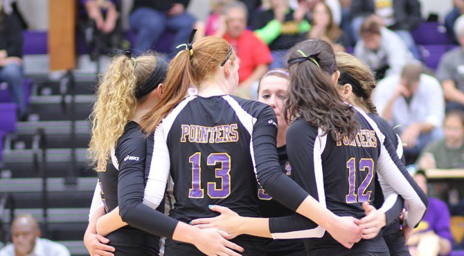 The Pointers huddle up during the game against UW-Eau Claire in the Wisconsin  Intercollegiate Athletic Conference Championship final on Saturday. The NCAA Division III  Tournament field will be announced on Monday, Nov. 5. Photo by Eva Donohoo.