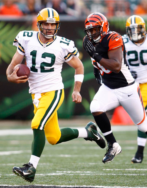 ​​Aaron Rodgers evades a pass rush from the Cincinatti Bengals  pass rush.  Photo courtesy of baynews9.com​​