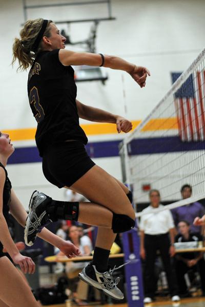 Allison Davis spikes the ball over the net. Photos by Jack Mclaughlin