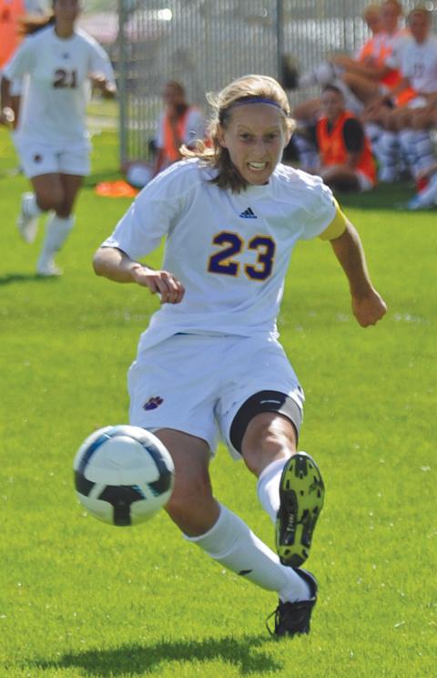Freshman Hannah Burt races down the field.                                                                               Photos by Mark Kinslow