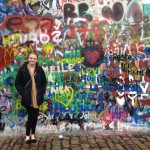 Mary in front of the John Lennon Wall in Prague. Photo courtesy of Mary Knight.