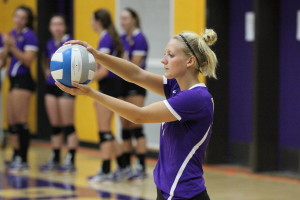 Junior Kendra Kundlinger gets ready to serve the ball at UW-Stevens Point Invitational. Photo by Kylie Bridenhagen.