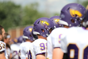 The UWSP football team looks on from the sideline during the Pointers season opening game against St. Norbert College on Sept. 3 in De Pere, Wis. Photo by Kylie Bridenhagen.
