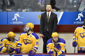 Tyler Krueger coaching during the 2015 national championship game. Photo by Jack McLaughlin.