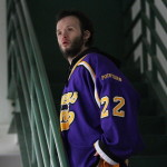 Joey Sosnowski, administrative assistant for the Pointer men's hockey team, watches the matchup between UWSP and St. Norbert on Saturday, Nov. 19 at Cornerstone Community Center in Ashwaubenon, Wis. Photo by Kylie Bridenhagen.