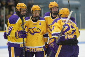 The No. 4 Pointer men's hockey team celebrates after senior forward Kyle Sharkey's goal against No. 2 Adrian College on Saturday, Dec. 10 at K.B. Willett Arena. Photo by Kylie Bridenhagen.