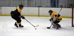 Goalie Sydney Conley goes 1 on 1 during a break away for UW Superior. Photo courtesy of Dalen Dahl.