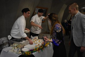 Christians Bistro's Chef serving their delicious truffle cheese sandwiches. Photo by Nomin Erdenebileg.