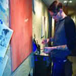 Tim Zeszutek painting in the DUC cases. Photo by Nomin Erdenebileg