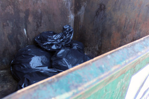 Garbage bags inside of a dumpster outside of Lower Debot. Photo courtesy of Dalen Dahl.