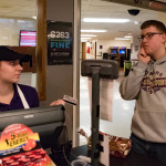 UWSP student making the difficult decision to use Dawg Dollars or a meal swipe at Lower Debot. Photo by Ross Vetterkind