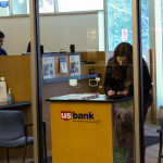 Student using the banking facilities in the Dreyfus University Center. Photo by Samantha Stein