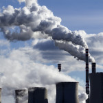 Carbon emissions coming from smoke stacks. Photo courtesy of salon.com.