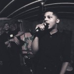 Dre Bates performing in a basement party. Photo provided by Dre Bates