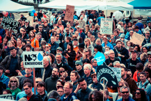 "A group of protestors against the Enbridge Pipeline. ""No Enbridge"" by Chris Yakimov is licensed under CC BY 2.0."
