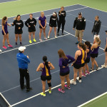 The tennis team gathers on the court. Photo courtesy of Erin Lemmer.