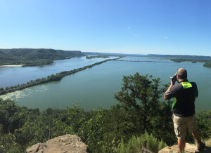 Taylor Drake takes photos on top of Trempealeau Mountain in Trempealeau, Wisconsin. Photo courtesy of Dalen Dahl.