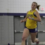 A UWSP runner rounds the corner. Photo courtesy of UWSP Athletics.