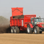 """A farmer spreading manure on a field. """"Manure Fertilizer"""" by eutrophication&hypoxia is licensed under CC BY 2.0"""